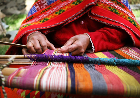 Indigenous artisan from Latin America weaving a Poncho by hand