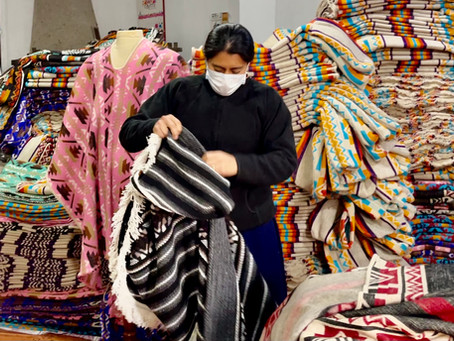 What is the role of indigenous women in the artisan communities of Ecuador?