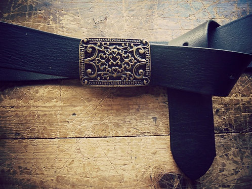 Leather belt with gold carved buckle