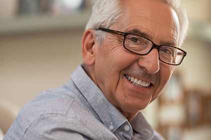 photograph of an elderly man wearing glasses