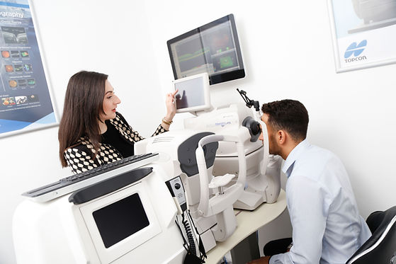 Optometrist performing an OCT scan on a patient
