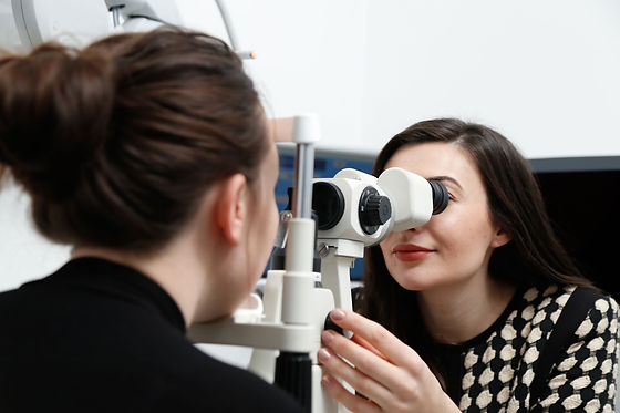 Photograph of an optometrist performing an eye exam