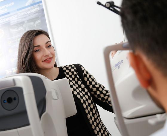 Optometrist explaining an OCT scan