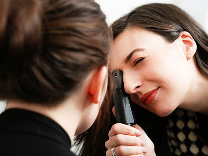 Optometrist examining a patients eye