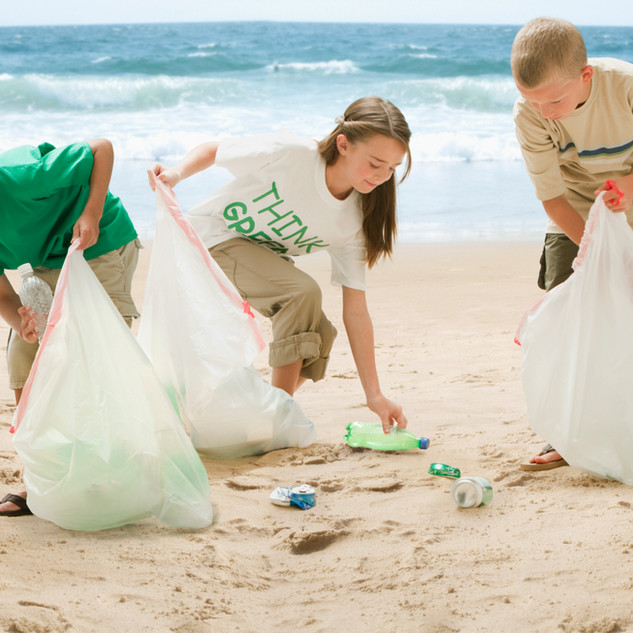 Children cleaning up the beach