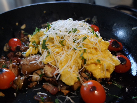 Fried wild mushrooms with bacon and scrambled egg