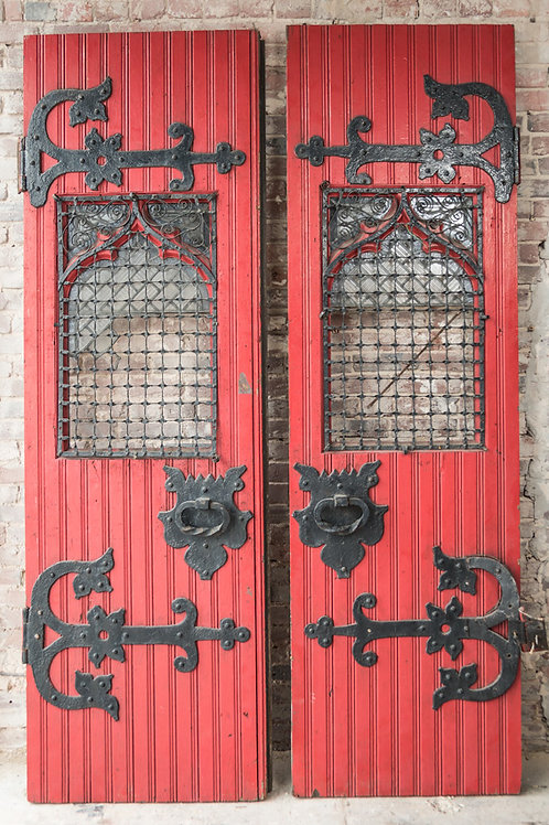 Red Episcopal church double doors with iron inserts