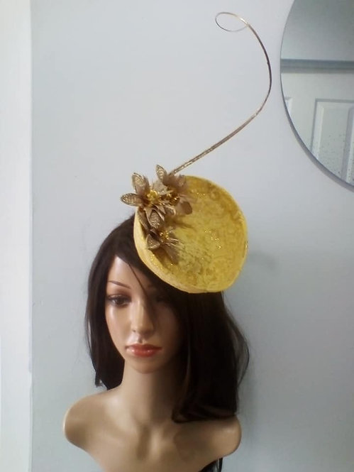 Yellow pearcher hat with gold quill and floral details
