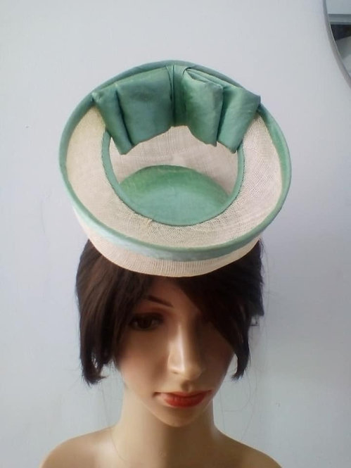 White percher hat with green detail