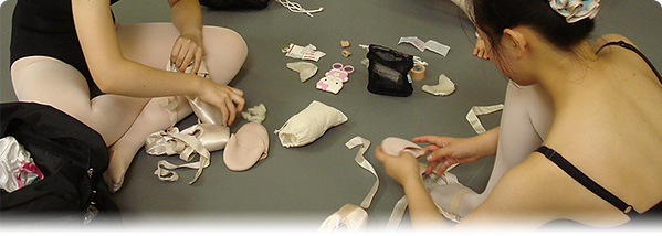 Ballet students working with pointe shoes