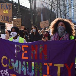 Over 100 protesters march through University City demanding Penn, Drexel pay PILOTs