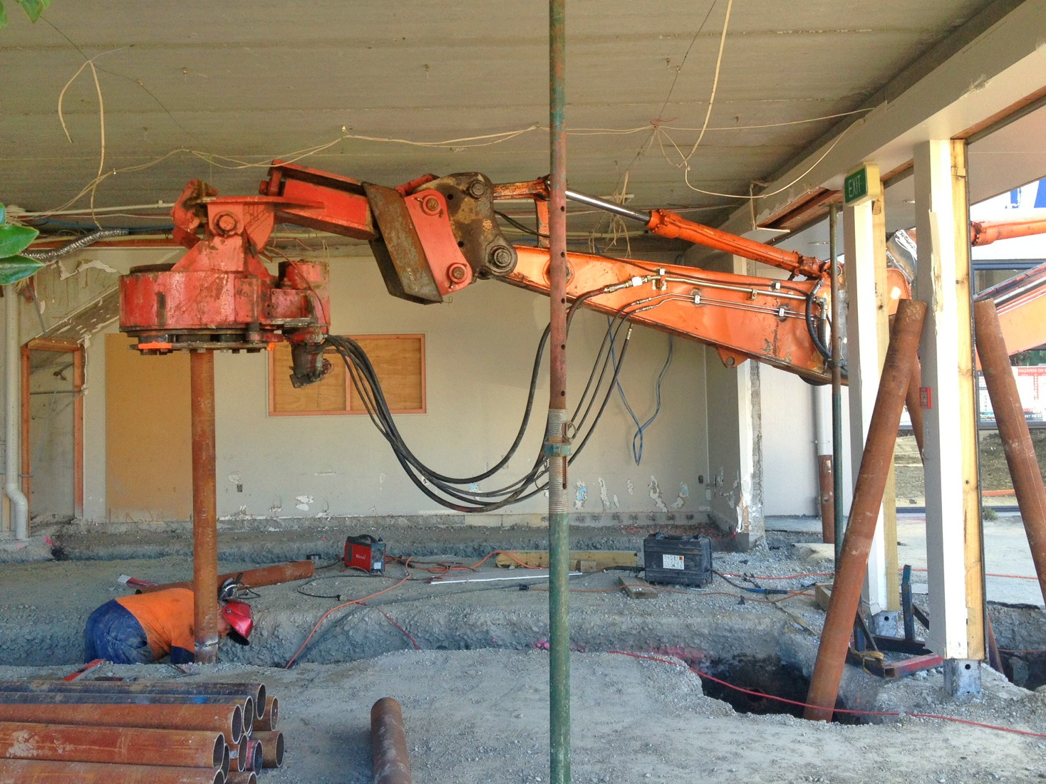 Screw piling in limited spaces