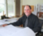 Drew at Desk background blur.jpg