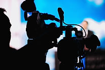 cameraman-recording-speaker-at-media-pre