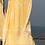 מגבת חוף greek צהובה תלויה בחוף הים