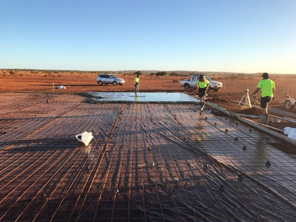 concrete being poured for the packing shed