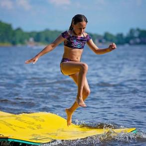 Girl jumping off Aqua Lily Pad.jpg