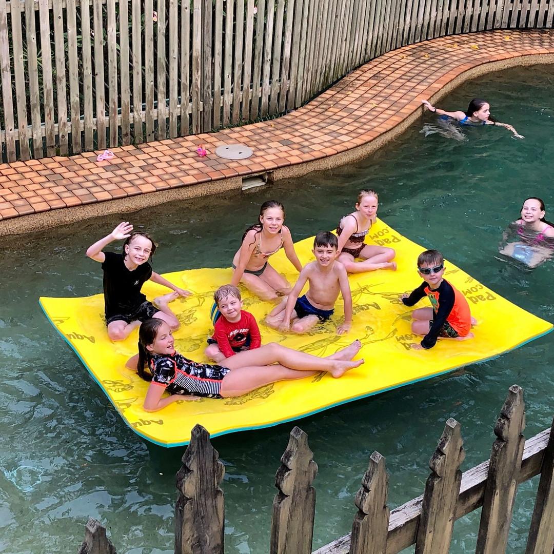 Kids on Aqua Lily Pad in pool.jpg