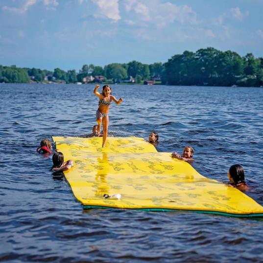 Girl running Aqua Lily Pad.jpg