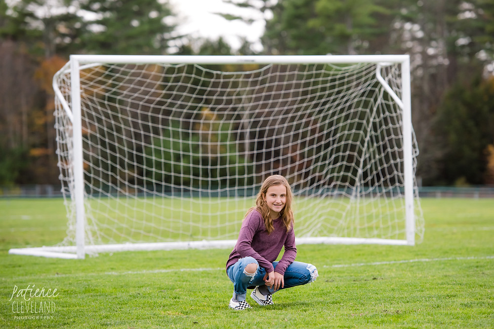 girl in soccer net
