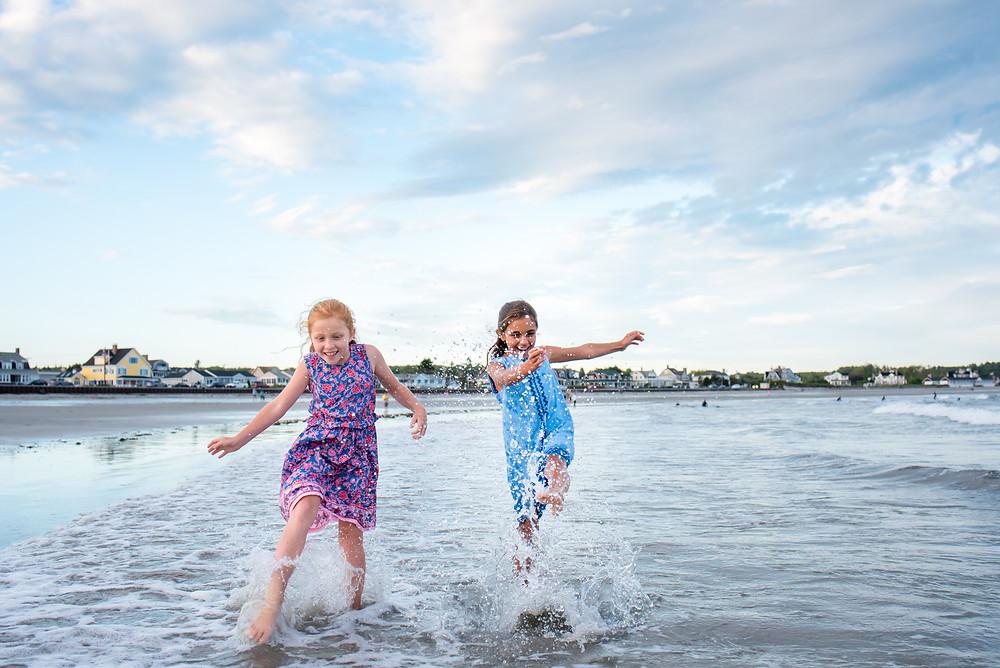 girls kicking water