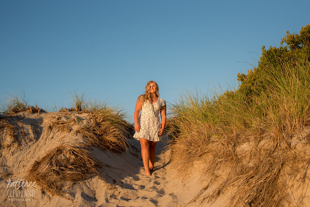 girl walking down dune