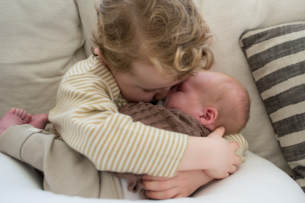 Newborn baby and brother