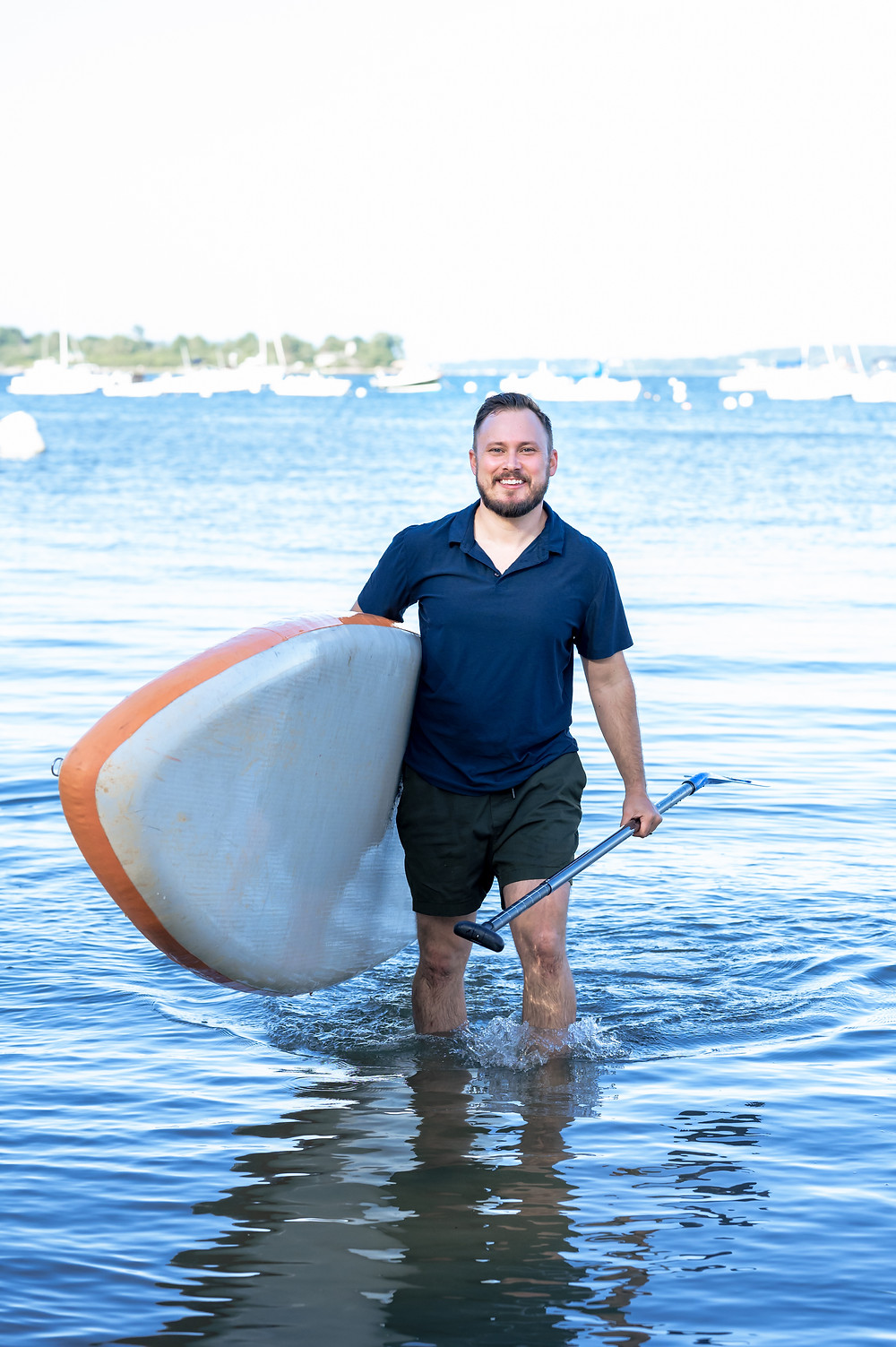 guy with paddle board smiling