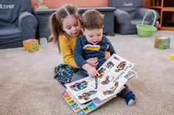 little kids reading a book.2018-3