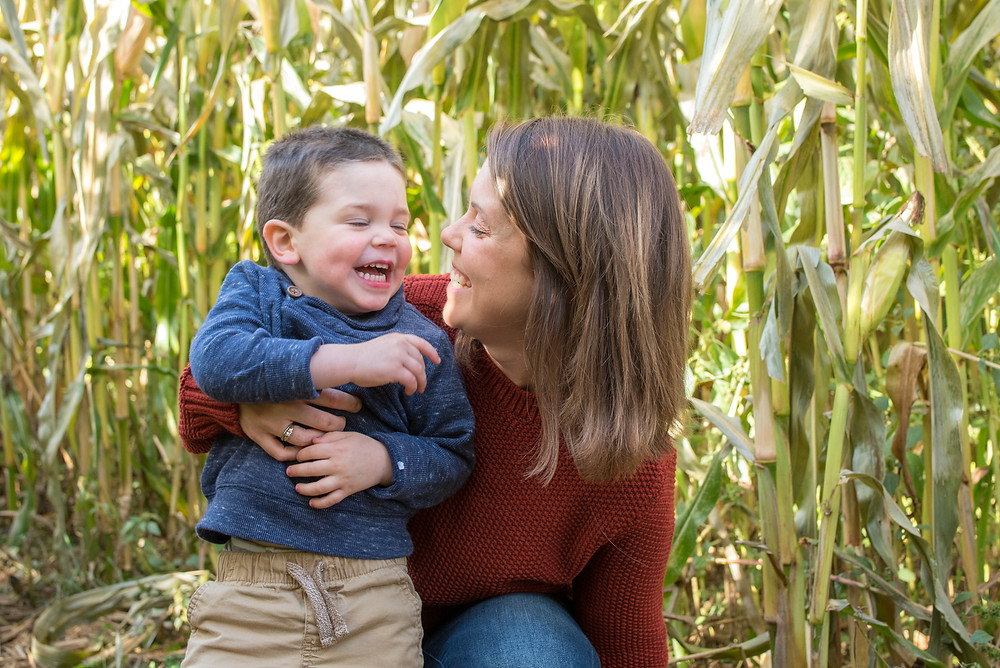 mom and boy laughing