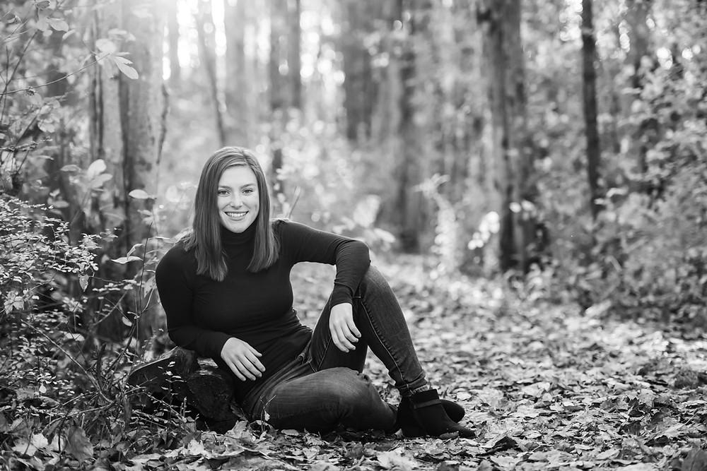 girl sitting on leaves