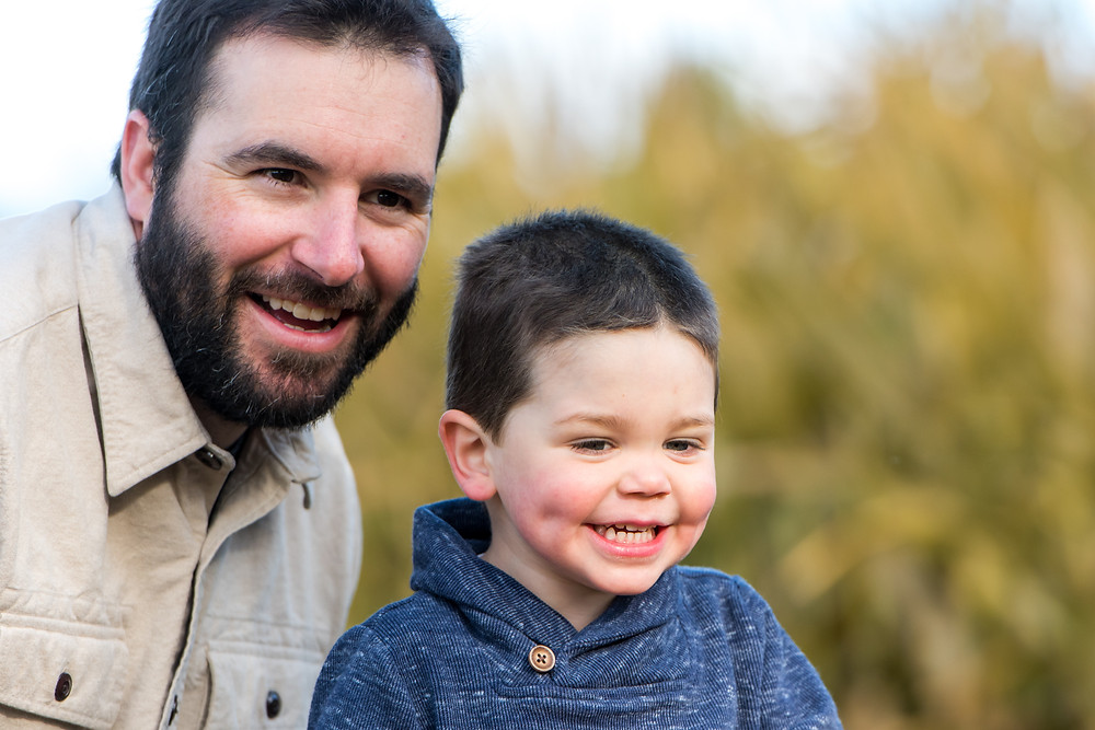 boy smiling with dad