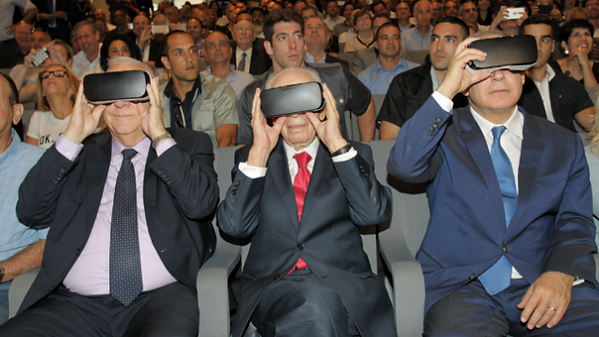 From left: Reuven Rivlin, Shimon Peres, Benjamin Netanyahu try on VR headsets at innovation center event, July 21, 2016 (Courtesy)