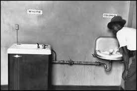 """In the Supreme Court case, Plessy v Ferguson, the Supreme Court determined that the practice of """"separate but equal"""" was constitutional as segregation alone did not violate the constitution. However, later on, the case of Brown v Board of Education abolished this practice when the Supreme Court ruled that segregation in schools was unconstitutional. (Elliott Erwitt/Magnum Photos)"""