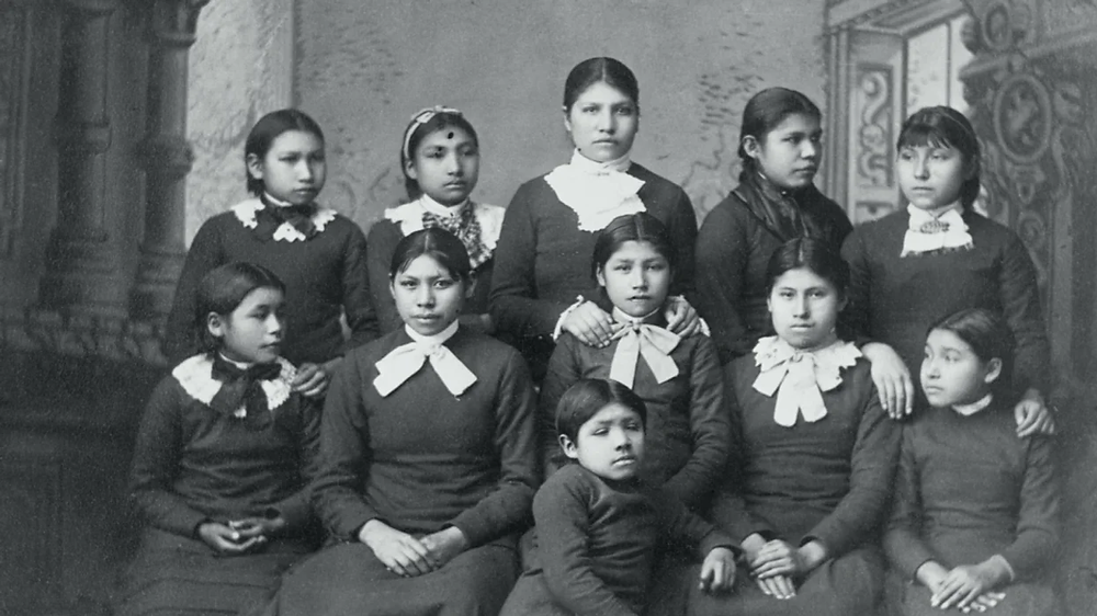 The cultural genocide of indigenous tribes: Colonizers forced the children into schools where they learned about Christianity and European values. They were stripped of their tribal clothing and were only allowed to speak English. The education system greatly idolizes the relation between the Natives and Colonizers as one of friendship, however the Europeans took advantage of their power to suppress the indigenous tribes.