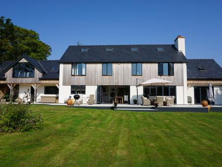 Aluminium Anthracite Doors and Windows transform 80s home along with cedar cladding