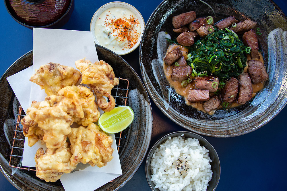 Tori Karaage (fried chicken, homemade tartar sauce, rice and misosoup) and the Koro Koro Steak (beefcubes on a misobutter, young spinach, rice and misosoup)