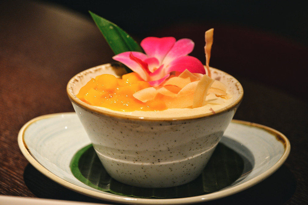 Coconut mousse with fresh mango