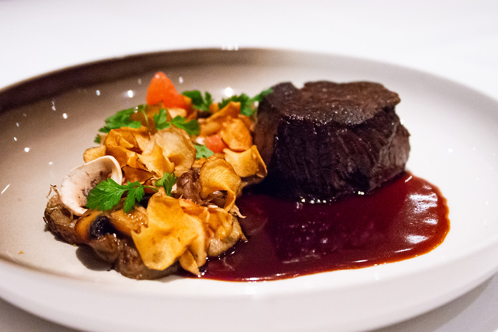 Swiss dry-aged prime beef fillet by Hatecke with sunchoke, mushrooms and grapefruit