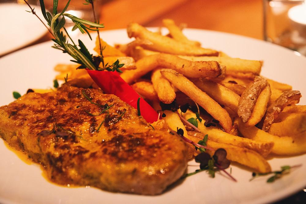 """Swiss beef entrecôte """"Café de Paris"""" with homemade French fries"""