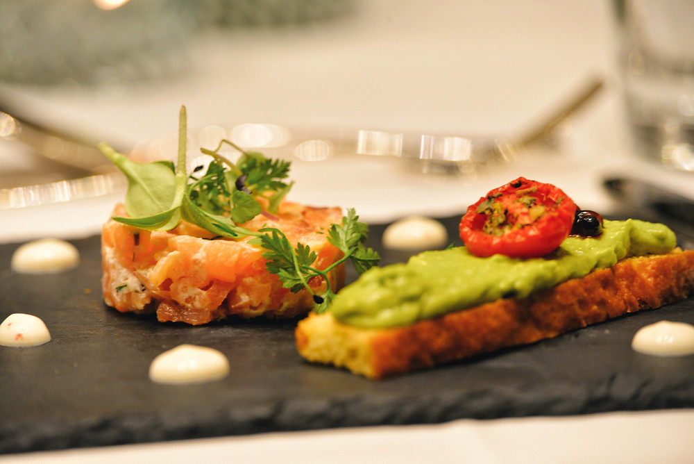 salmon tartare with an avocado brioche and herbs