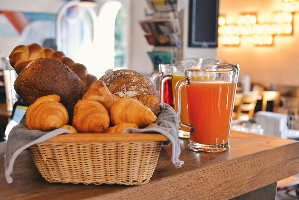 different kinds of bread such as Zopf, Croissants, whole grain breads and juices
