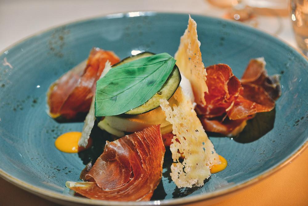 Parmigiana with eggplant, tomato, buffalo mozzarella and raw ham