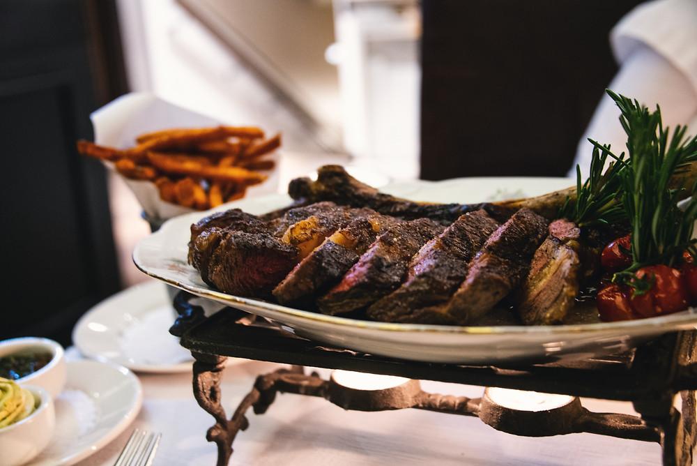 Tomahawk steak with sweet potato fries