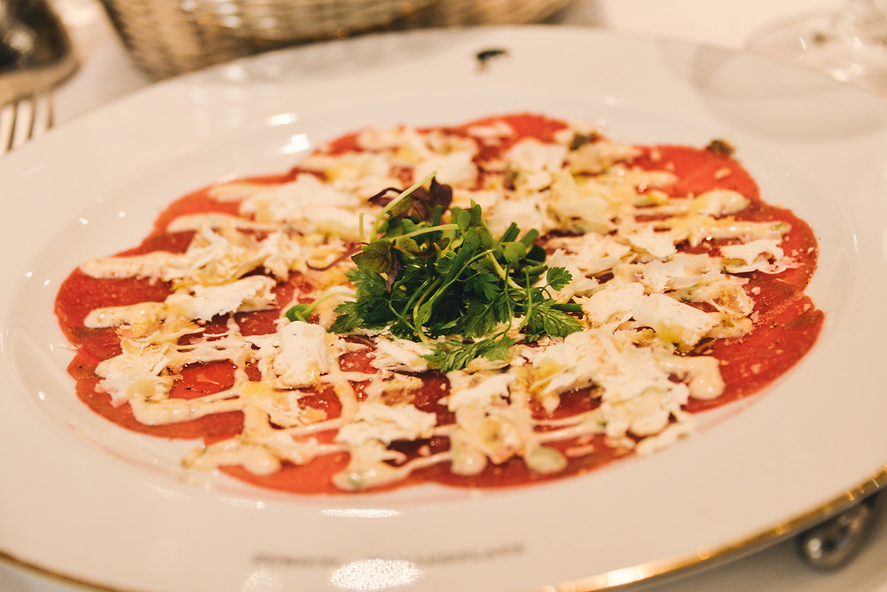 heavily spiced beef carpaccio in honey mustard dressing with Belper tuber
