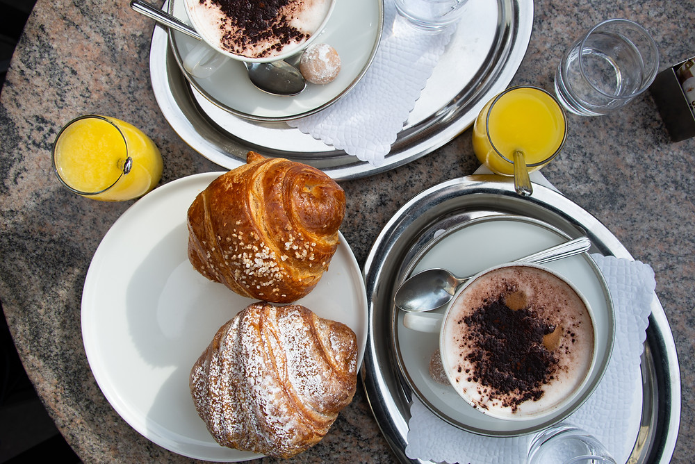 tasty cappuccino, an orange juice and a brioche filled with jam and vanilla | Taste my Swiss City in Locarno