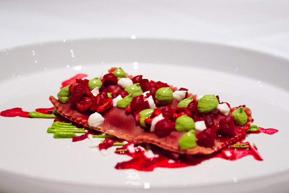 beetroot ravioli with hazelnut, ricotta and purslane