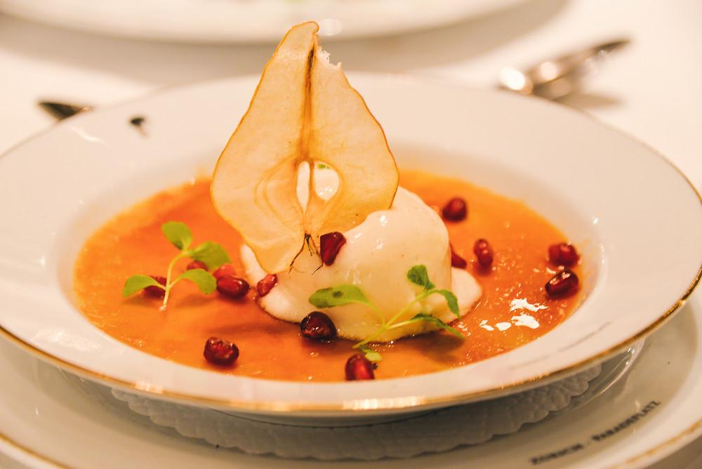 hazelnut crème brûlée accompanied by pear sorbet and pomegranate