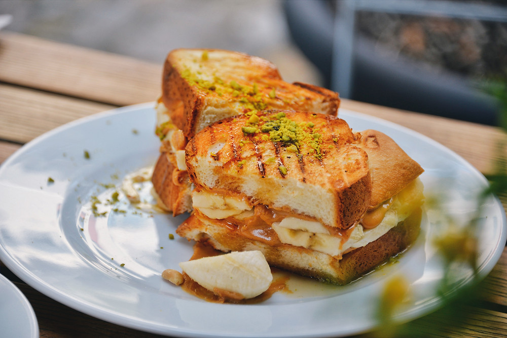 """Hot Zopf"", toasted Zopf with peanut butter, banana, maple syrup and pistachios"