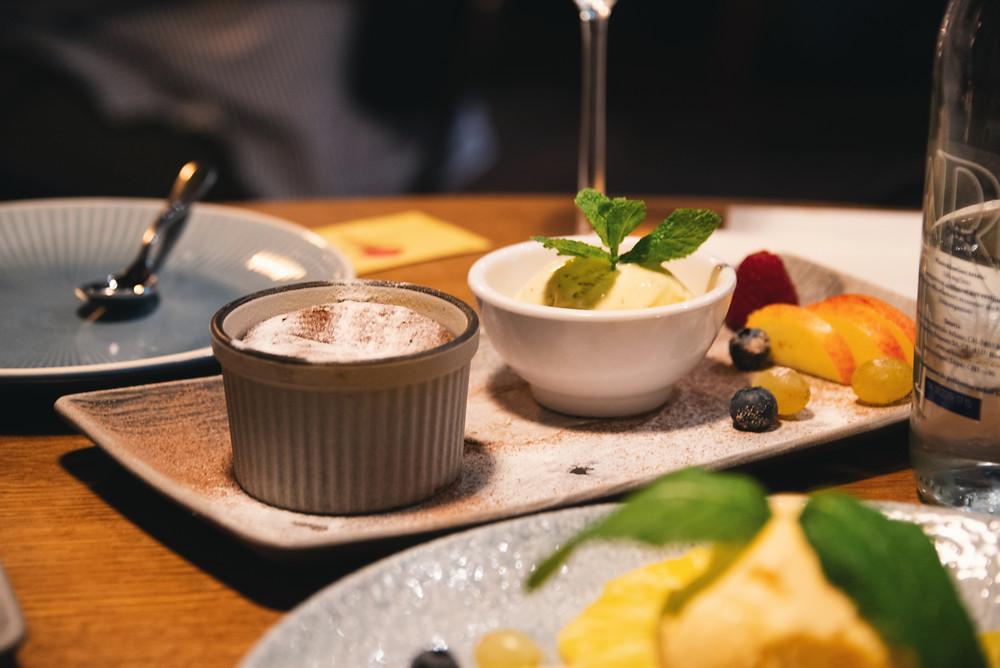 a warm chocolate tartlet with vanilla ice cream